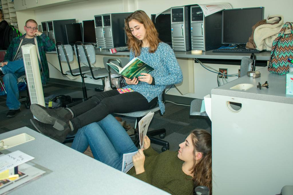 Seniors Claire Kelly and Andreea Bodea studying away. Photo taken by senior Kylie Saxton.