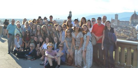 Last year's students gathered for a group photo in front of a breathtaking view.