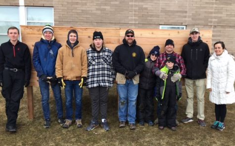 Sinacola, far right, students and community members pose in front of the compost bin in Alumni Arbor March 2019.