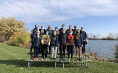 The teams pose for a picture at Lake Erie Metropark after winning Regionals on Saturday, October 31st.