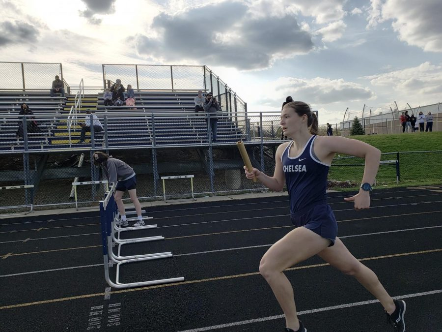 Riley Thorburn expands Chelsea's lead in the Kruse Relay during her 600 meter leg.