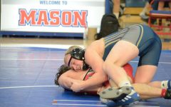 Cole Munson Pins Fourth Place State Finish