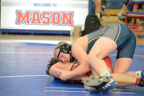 Cole Munson Pins Fourth Place State Finish